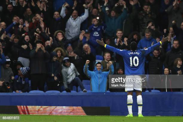 Romelu Lukaku of Everton celebrates with fans as he scores their fourth goal during the Premier League match between Everton and Hull City at...