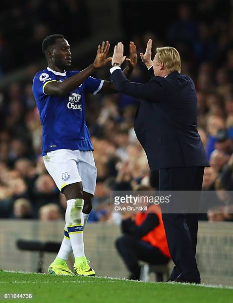 Romelu Lukaku of Everton celebrates with Ronald Koeman manager of Everton as he scores their first goal from a free kick during the Premier League...