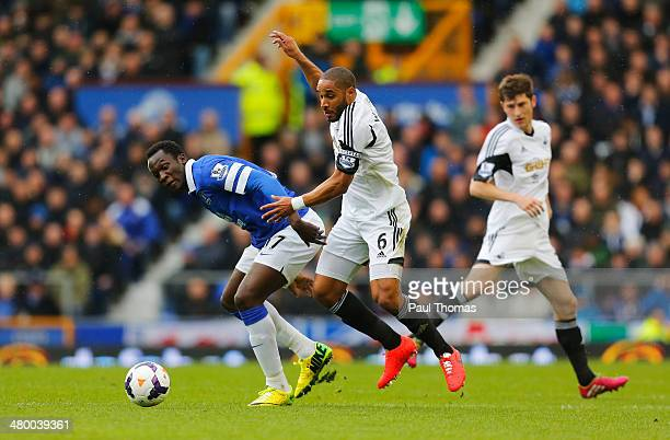 Romelu Lukaku of Everton challenges Ashley Williams of Swansea City during the Barclays Premier League match between Everton and Swansea City at...
