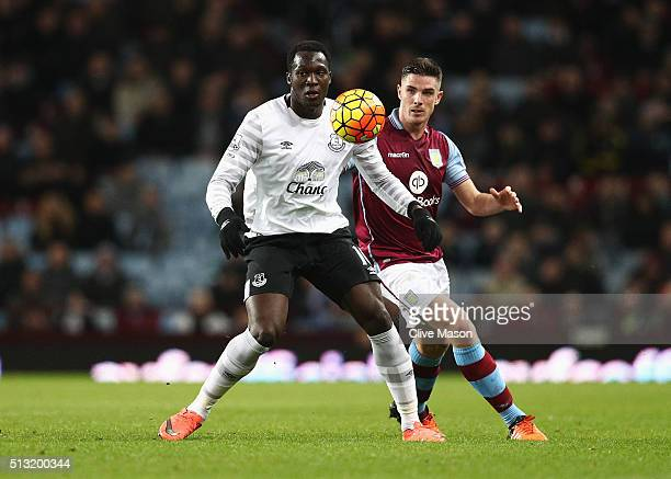 Romelu Lukaku of Everton controls the ball under pressure of Ciaran Clark of Aston Villa during the Barclays Premier League match between Aston Villa...
