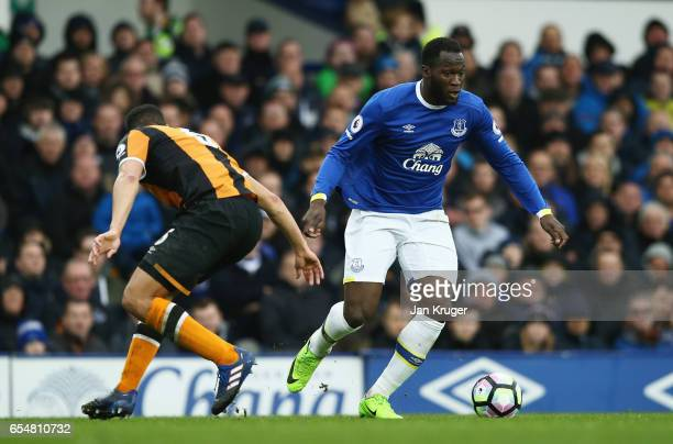 Romelu Lukaku of Everton evades Curtis Davies of Hull City during the Premier League match between Everton and Hull City at Goodison Park on March 18...