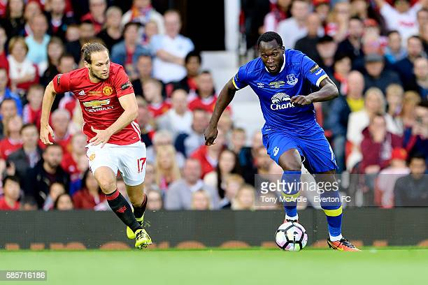 Romelu Lukaku of Everton evades Daley Blind of Manchester United during the Wayne Rooney testimonial match between Manchester United and Everton at...