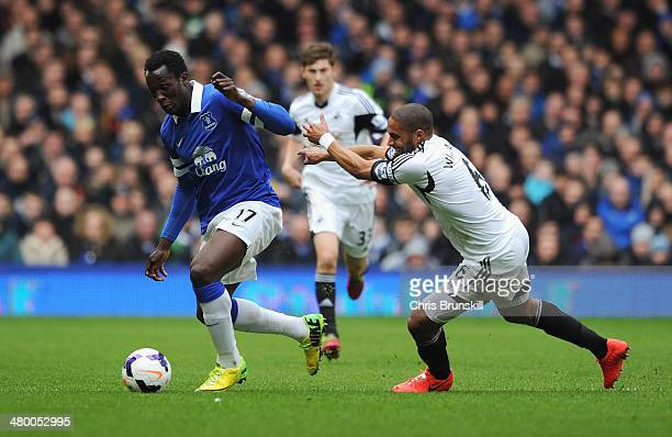 Romelu Lukaku of Everton goes past Ashley Williams of Swansea City during the Barclays Premier League match between Everton and Swansea City at...