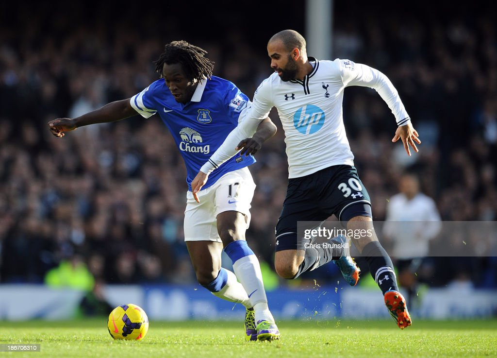 Romelu Lukaku of Everton in action with Sandro of Tottenham Hotspur during the Barclays Premier League match between Everton and Tottenham Hotspur at Goodison Park on November 03, 2013 in Liverpool, England.