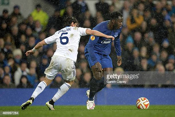 Romelu Lukaku of Everton is challenged by Aleksandr Dragovic of Dynamo Kyiv during the UEFA Europa League Round of 16 first leg match between Everton...