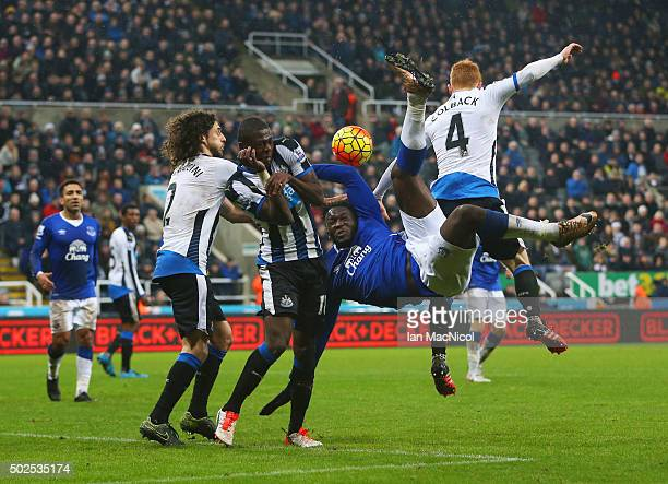 Romelu Lukaku of Everton is challenged by Fabricio Coloccini Chancel Mbemba and Jack Colback of Newcastle United as he attempts an overhead kick...