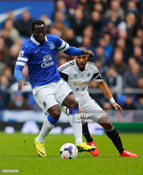 Romelu Lukaku of Everton is closed down by Ashley Williams of Swansea City during the Barclays Premier League match between Everton and Swansea City...