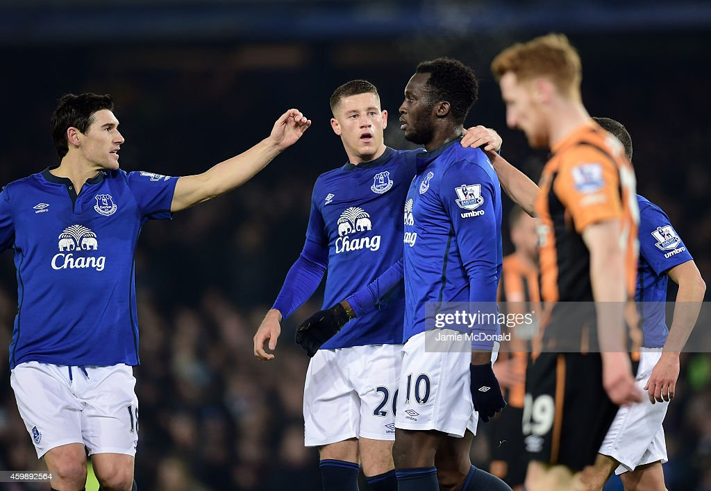 Romelu Lukaku (R) of Everton is congratulated by teammates Gareth Barry (L) and Ross Barkley (C) after scoring the opening goal during the Barclays Premier League match between Everton and Hull City at Goodison Park on December 3, 2014 in Liverpool, England.