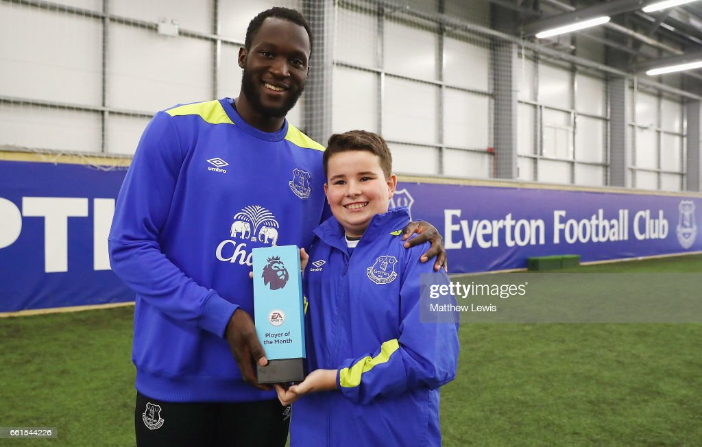 Romelu Lukaku of Everton is presented with the EA SPORTS Player of the Month award from Logan at USM Finch Farm on March 30, 2017 in Halewood, England.