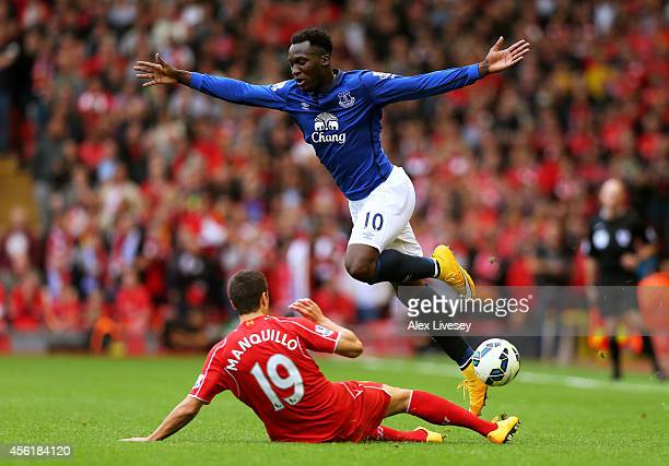 Romelu Lukaku of Everton is tackled by Javi Manquillo of Liverpool during the Barclays Premier League match between Liverpool and Everton at Anfield...
