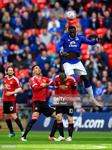 Romelu Lukaku of Everton outjumps Wayne Rooney and Chris Smalling of Manchester United during The Emirates FA Cup semi final match between Everton...