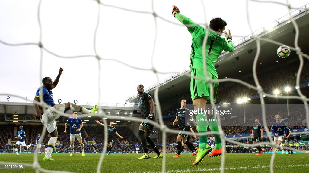 Romelu Lukaku of Everton scores his sides third goal past goalkeeper Ben Foster of West Bromwich Albion during the Premier League match between Everton and West Bromwich Albion at Goodison Park on March 11, 2017 in Liverpool, England.