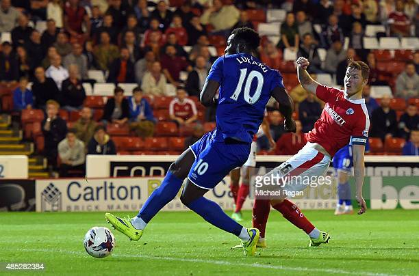 Romelu Lukaku of Everton scores his team's third goal during the Capital One Cup second round match between Barnsley and Everton at Oakwell Stadium...