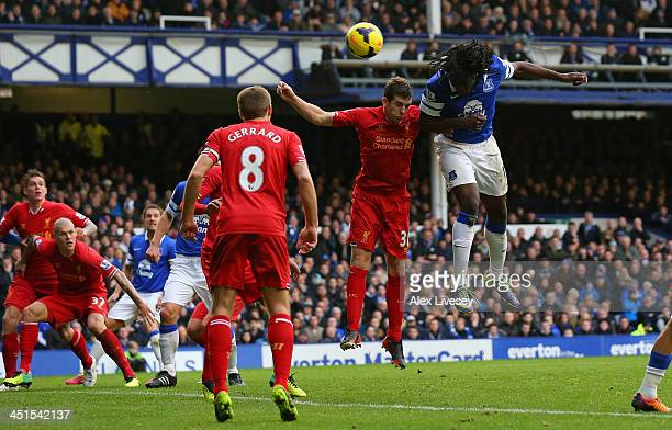 Romelu Lukaku of Everton scores his team's third goal during the Barclays Premier League match between Everton and Liverpool at Goodison Park on...
