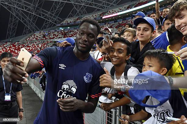 Romelu Lukaku of Everton takes a selfie with fans during the Everton FC open training ahead of the match between Everton and Stoke City during the...