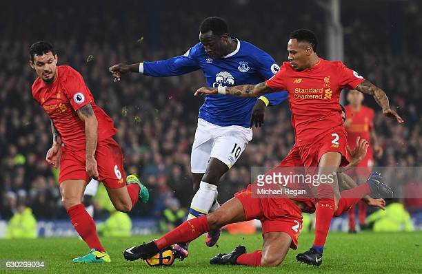 Romelu Lukaku of Everton takes on Dejan Lovren Emre Can and Nathaniel Clyne of Liverpool during the Premier League match between Everton and...
