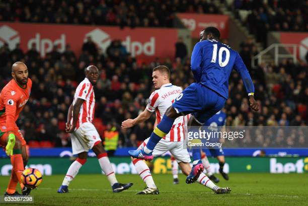 Romelu Lukaku of Everton watches as the ball flies in to the net deflected by Ryan Shawcross of Stoke City during the Premier League match between...