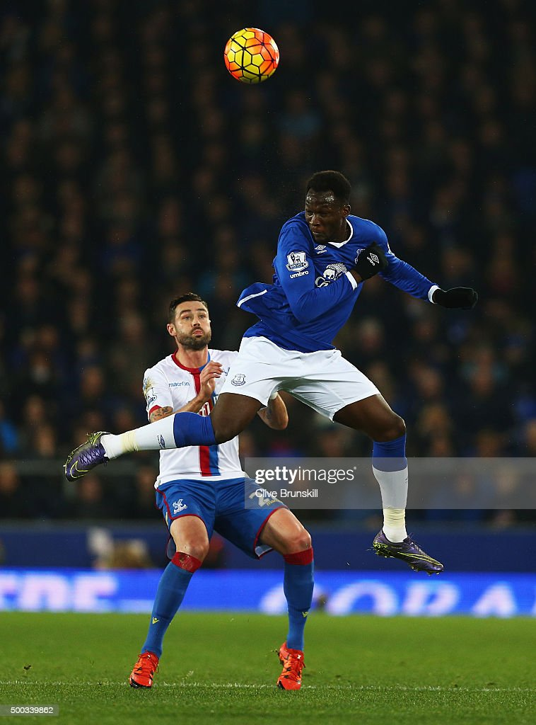 Romelu Lukaku of Everton wins a header from Damien Delaney of Crystal Palace during the Barclays Premier League match between Everton and Crystal Palace at Goodison Park on December 7, 2015 in Liverpool, England.