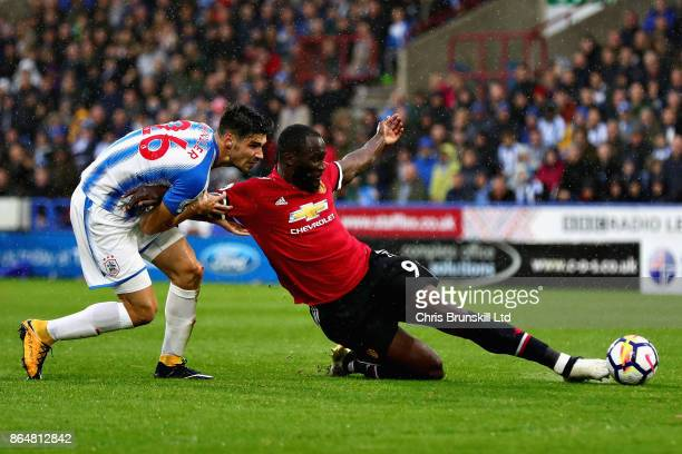 Romelu Lukaku of Manchester United attempts a shot as he is challenged by Christopher Schindler of Huddersfield Town during the Premier League match...