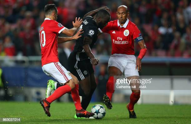 Romelu Lukaku of Manchester United battles with Jonas and Luisao of Benfica during the UEFA Champions League group A match between SL Benfica and...