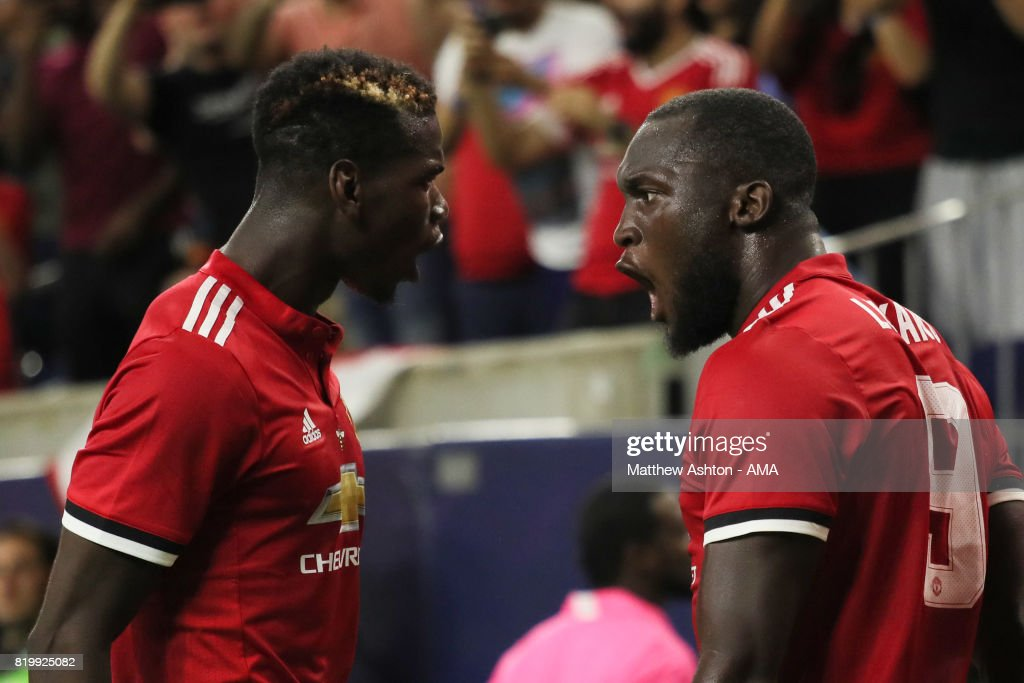 Romelu Lukaku of Manchester United celebrates after scoring a goal to make it 1-0 with Paul Pogba during the International Champions Cup 2017 match between Manchester United and Manchester City at NRG Stadium on July 20, 2017 in Houston, Texas.