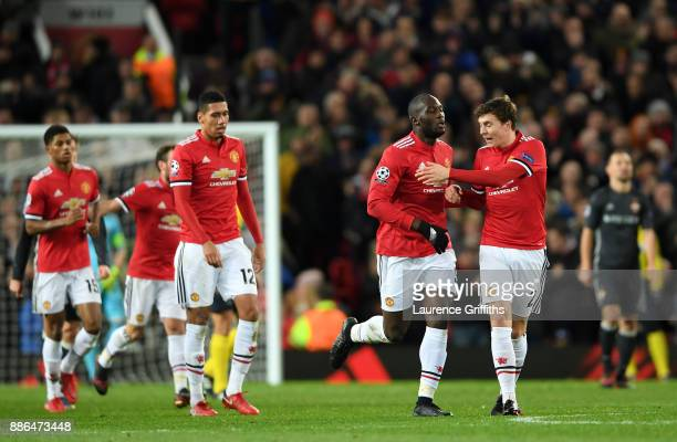 Romelu Lukaku of Manchester United celebrates after scoring his sides first goal with Victor Lindelof of Manchester United during the UEFA Champions...