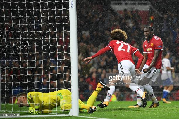 Romelu Lukaku of Manchester United celebrates his sides first goal as Marouane Fellaini of Manchester United celebrates scoring his sides first goal...