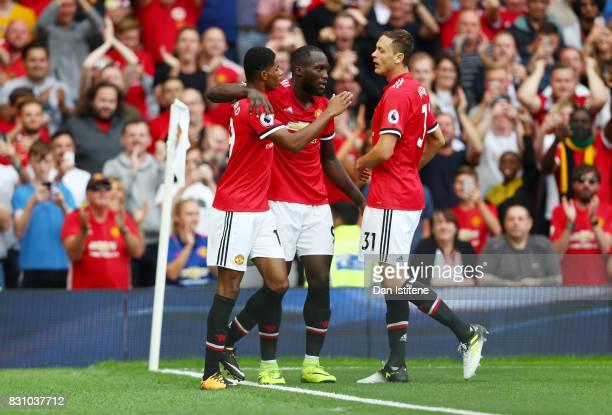 Romelu Lukaku of Manchester United celebrates scoring his sides first goal with Nemanja Matic of Manchester United and Marcus Rashford of Manchester...