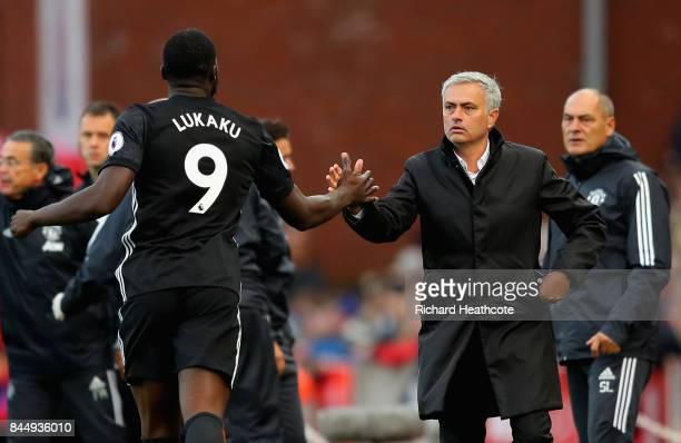 Romelu Lukaku of Manchester United celebrates scoring his sides second goal with Jose Mourinho Manager of Manchester United during the Premier League...
