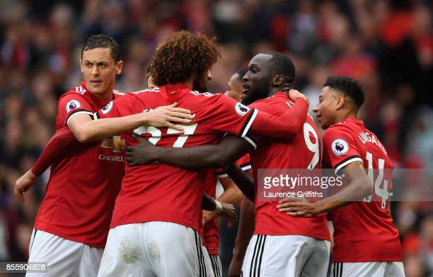 Romelu Lukaku of Manchester United celebrates scoring his side's fourth goal with his team mates during the Premier League match between Manchester...