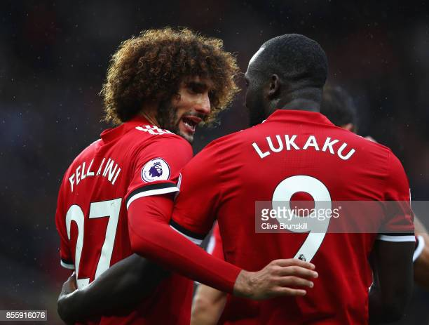 Romelu Lukaku of Manchester United celebrates scoring his side's fourth goal with his team mate Marouane Fellaini during the Premier League match...