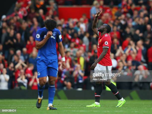 Romelu Lukaku of Manchester United celebrates scoring his sides third goal as Ashley Williams of Everton looks dejected during the Premier League...