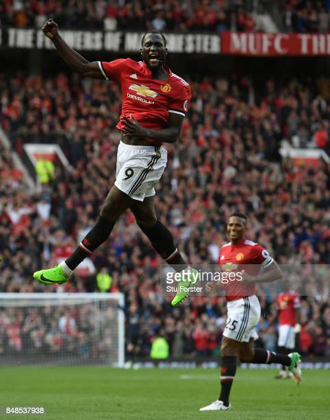 Romelu Lukaku of Manchester United celebrates scoring his sides third goal during the Premier League match between Manchester United and Everton at...