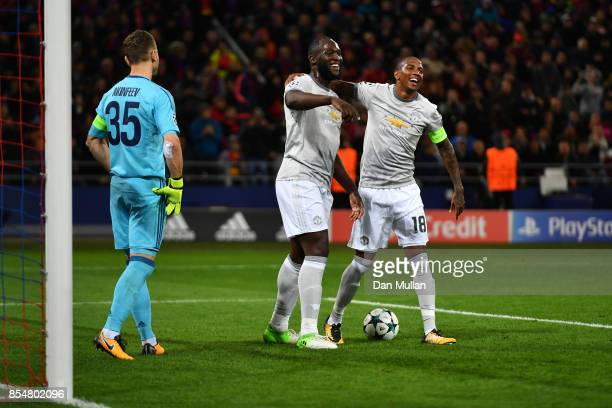 Romelu Lukaku of Manchester United celebrates with Ashley Young of Manchester United after scoring his second and his sides third goal during the...