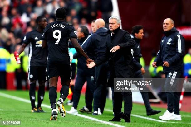 Romelu Lukaku of Manchester United celebrates with manager Jose Mourinho after scoring his side's second goal during the Premier League match between...