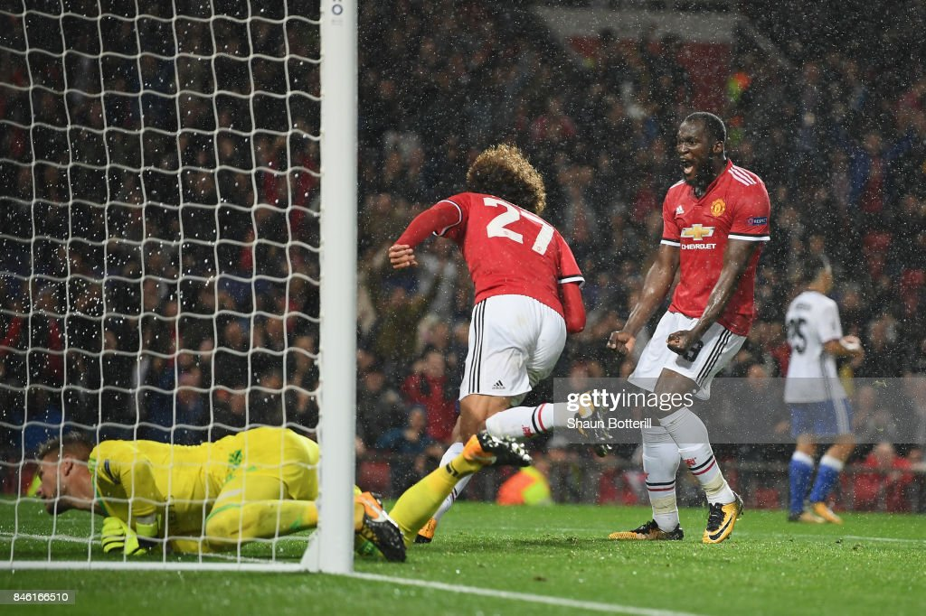 Romelu Lukaku of Manchester United celebrates with Marouane Fellaini of Manchester United after the first goal during the UEFA Champions League group A match between Manchester United and FC Basel at Old Trafford on September 12, 2017 in Manchester, United Kingdom.