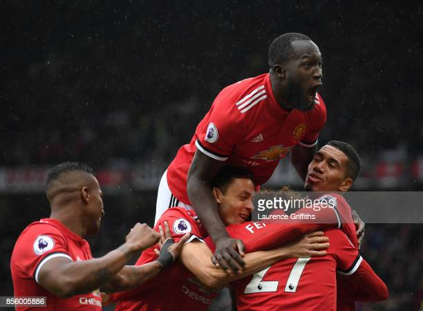 Romelu Lukaku of Manchester United congratulates Marouane Fellaini on scoring the third goal during the Premier League match between Manchester...