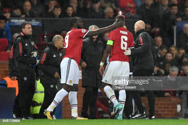Romelu Lukaku of Manchester United embraces Paul Pogba of Manchester United as he is forced off with a injury during the UEFA Champions League Group...