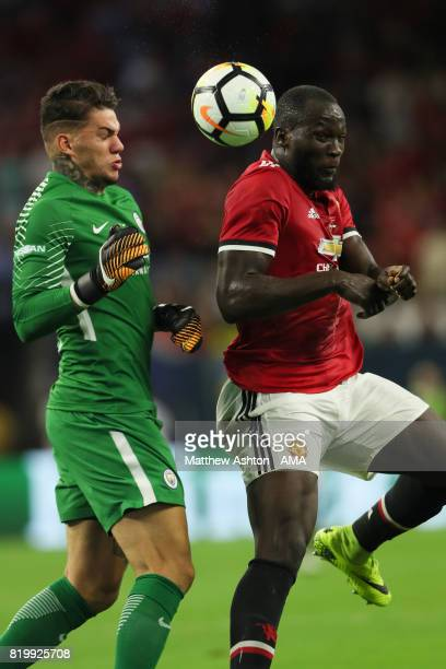 Romelu Lukaku of Manchester United gets the ball past goalkeeper Ederson of Manchester City before scoring a goal to make it 10 during the...