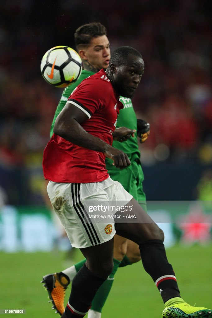 Romelu Lukaku of Manchester United gets the ball past goalkeeper Ederson of Manchester City before scoring a goal to make it 1-0 during the International Champions Cup 2017 match between Manchester United and Manchester City at NRG Stadium on July 20, 2017 in Houston, Texas.