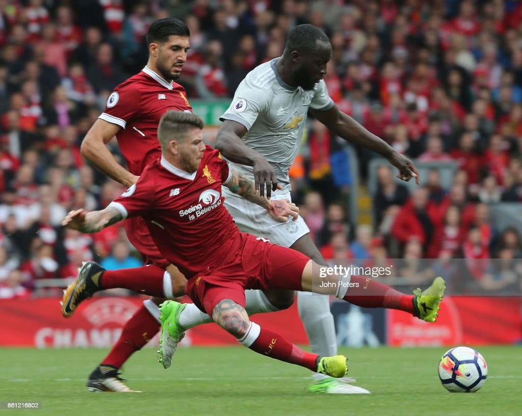 Romelu Lukaku of Manchester United in action with Alberto Moreno of Liverpool during the Premier League match between Liverpool and Manchester United at Anfield on October 14, 2017 in Liverpool, England.
