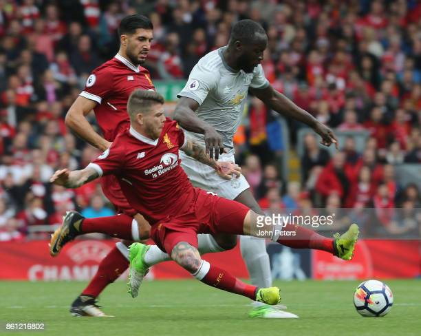 Romelu Lukaku of Manchester United in action with Alberto Moreno of Liverpool during the Premier League match between Liverpool and Manchester United...