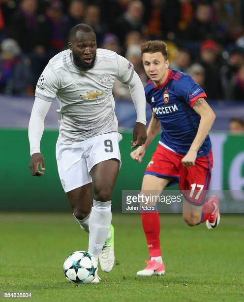 Romelu Lukaku of Manchester United in action with Aleksandr Golovin of CSKA Moscow during the UEFA Champions League group A match between CSKA Moskva...