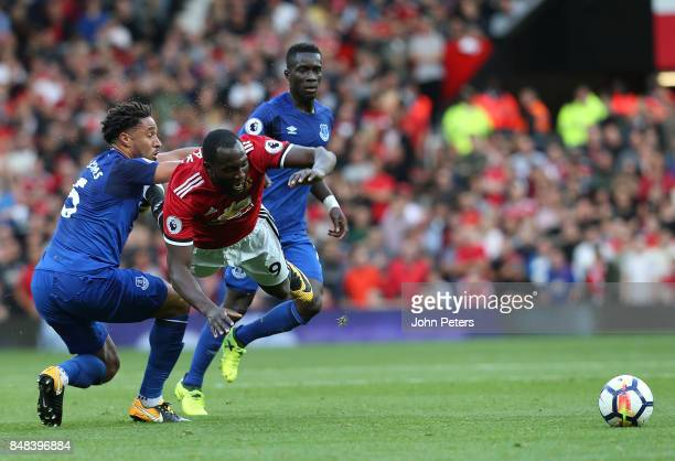 Romelu Lukaku of Manchester United in action with Ashley Williams of Everton during the Premier League match between Manchester United and Everton at...