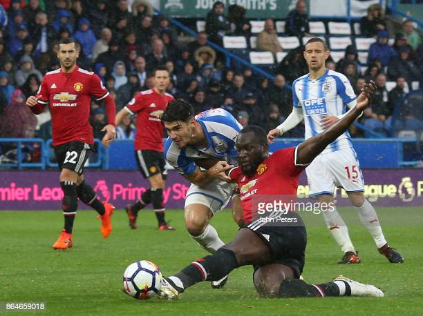 Romelu Lukaku of Manchester United in action with Christopher Schindler of Huddersfield Town during the Premier League match between Huddersfield...