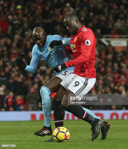 Romelu Lukaku of Manchester United in action with Eliaquim Mangala of Manchester City during the Premier League match between Manchester United and...