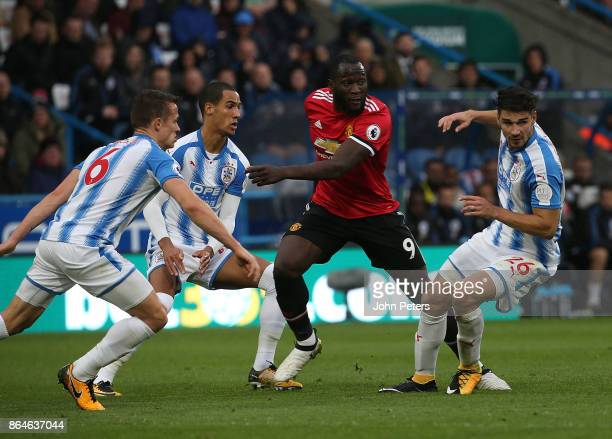 Romelu Lukaku of Manchester United in action with Jonathan Hogg Tom Ince and Christopher Schindler of Huddersfield Town during the Premier League...
