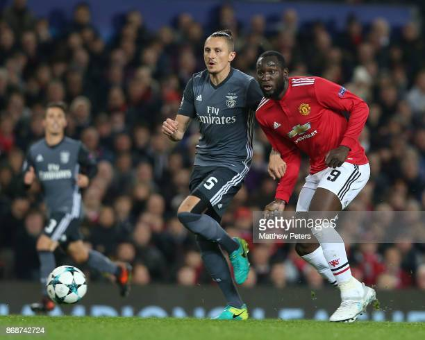 Romelu Lukaku of Manchester United in action with Ljubomir Fejsa of Benfica during the UEFA Champions League group A match between Manchester United...