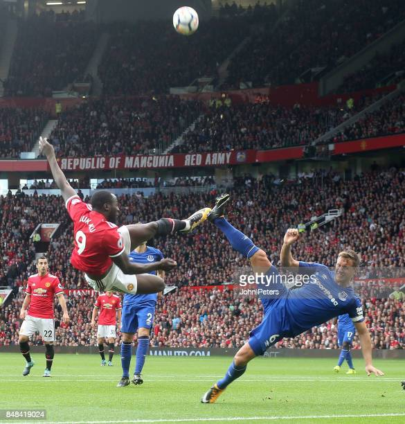 Romelu Lukaku of Manchester United in action with Phil Jagielka of Everton during the Premier League match between Manchester United and Everton at...