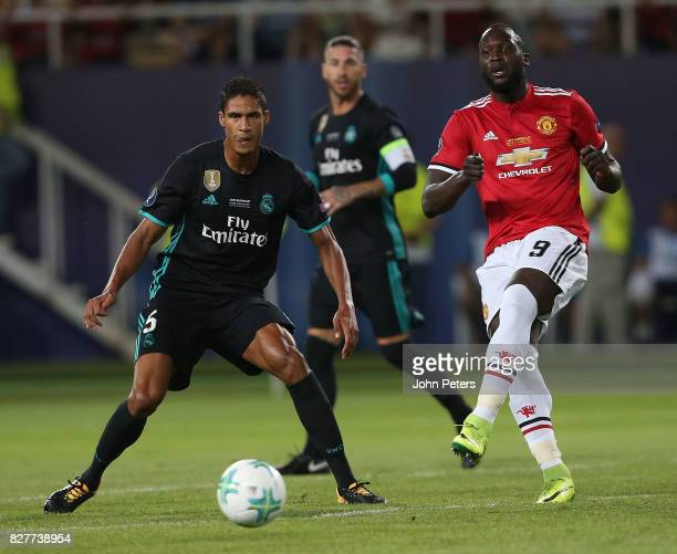 Romelu Lukaku of Manchester United in action with Raphael Varane of Real Madrid during the UEFA Super Cup match between Real Madrid and Manchester...